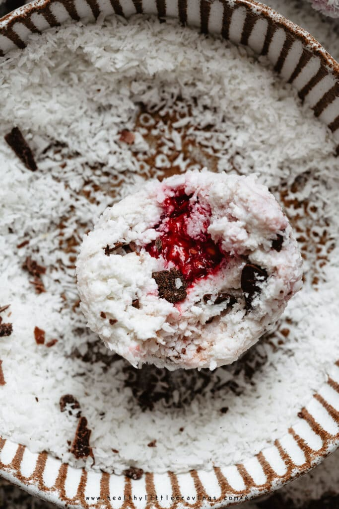 Closeup of coconut balls with raspberry in the center