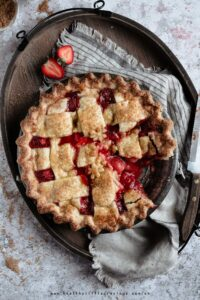 Strawberry pie with missing piece onto a tray