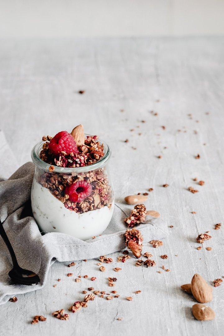 healthy raspberry granola served into a jar