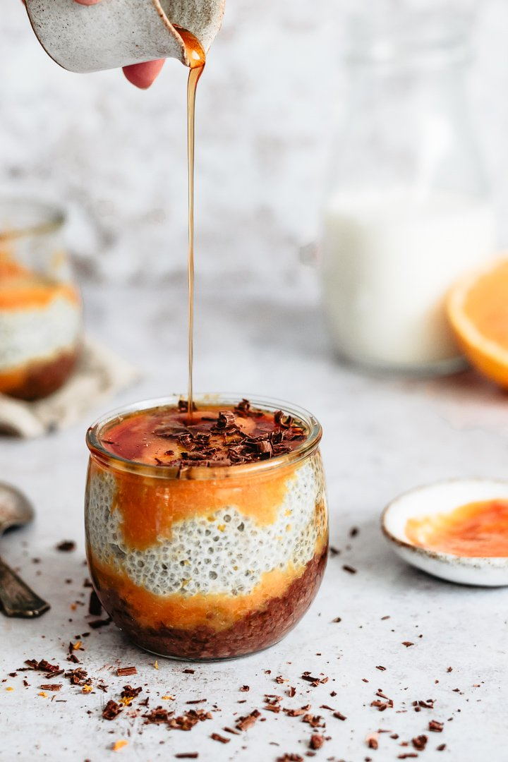 Chocolate chia pudding with orange purée served with maple syrup
