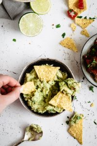 Guacamole served into a bowl with nachos
