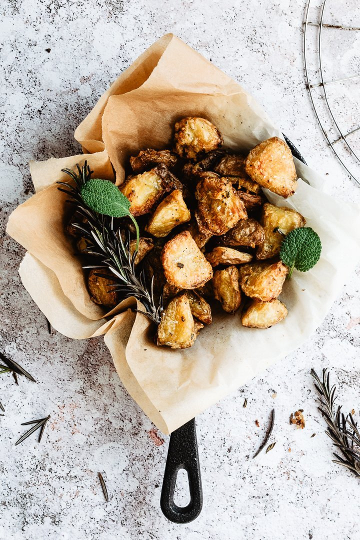 Oven roasted potatoes served in a cast iron skillet
