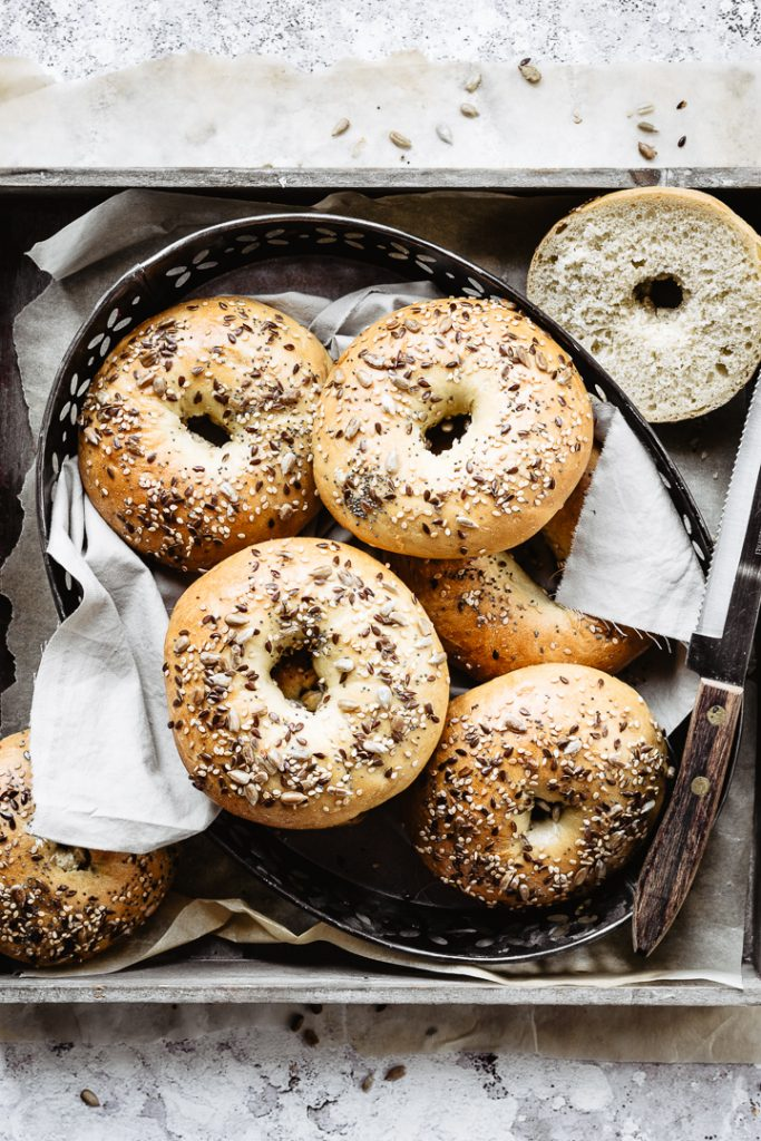 Healthy homemade bagels on a tray ready to be cut