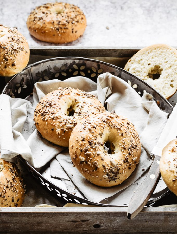 Homemade bagels are the best: soft and chewy bagels on a baking tray