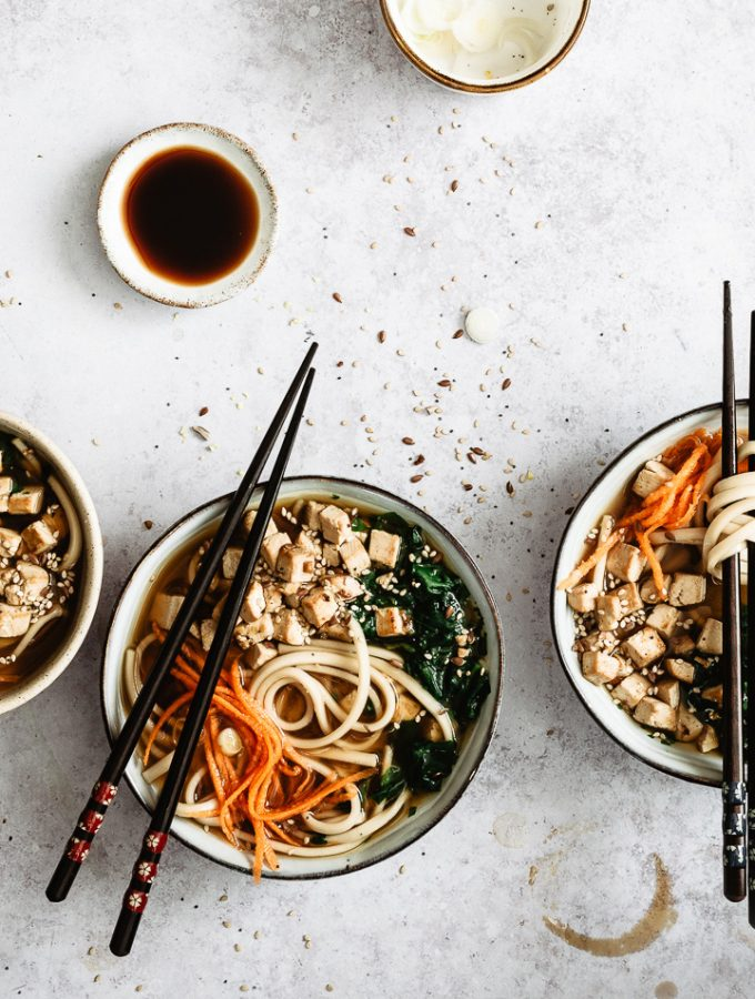 Vegan noodle soup with udon noodles served in a bowl