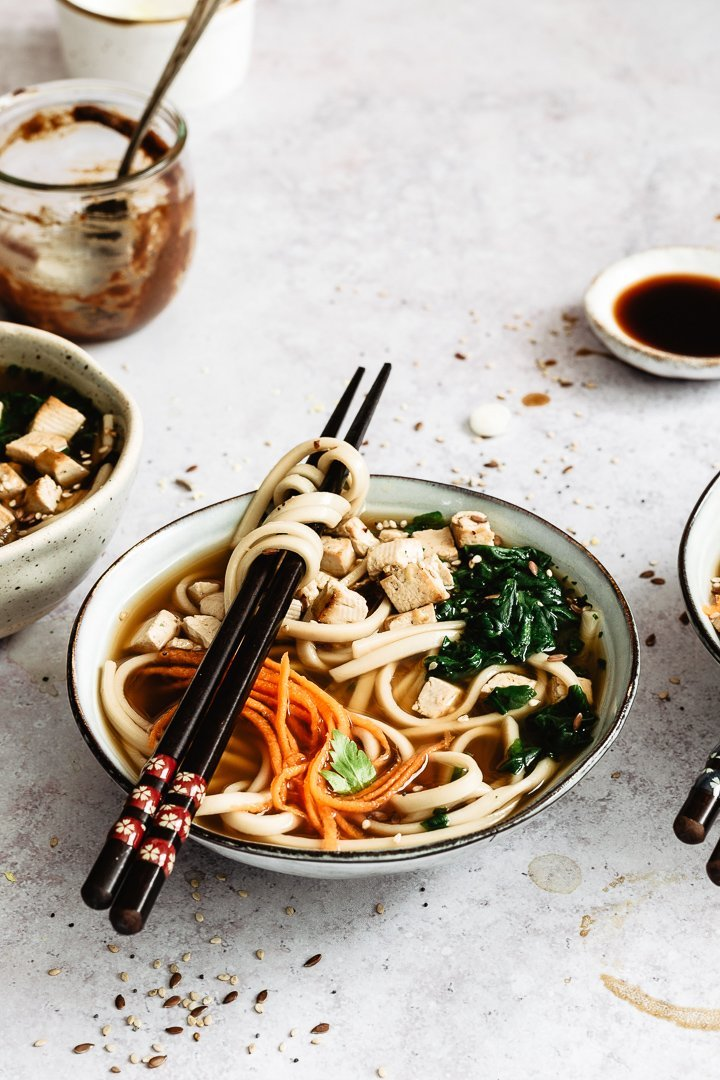 Easy and quick vegan ramen recipe. Soup served in a bowl with chopsticks