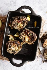 Easy peasy roasted artichoke halves into a casserole