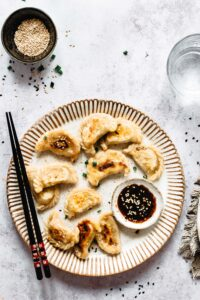 Easy vegan potstickers recipe: potstickers on a plate with sauce