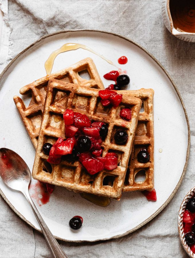 No baking powder powder waffles topped with strawberries and blueberries