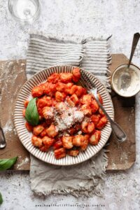 A plate of italian gnocchi with parmesan cheese