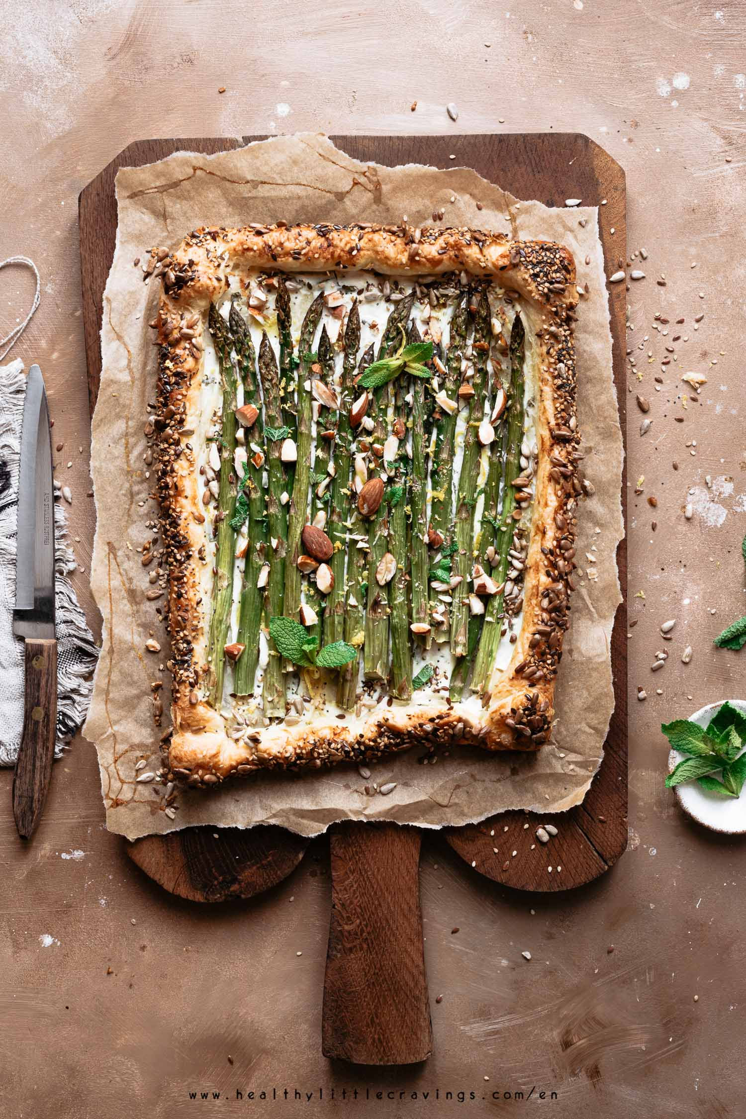 Asparagus tart on a rustic wooden cutting board