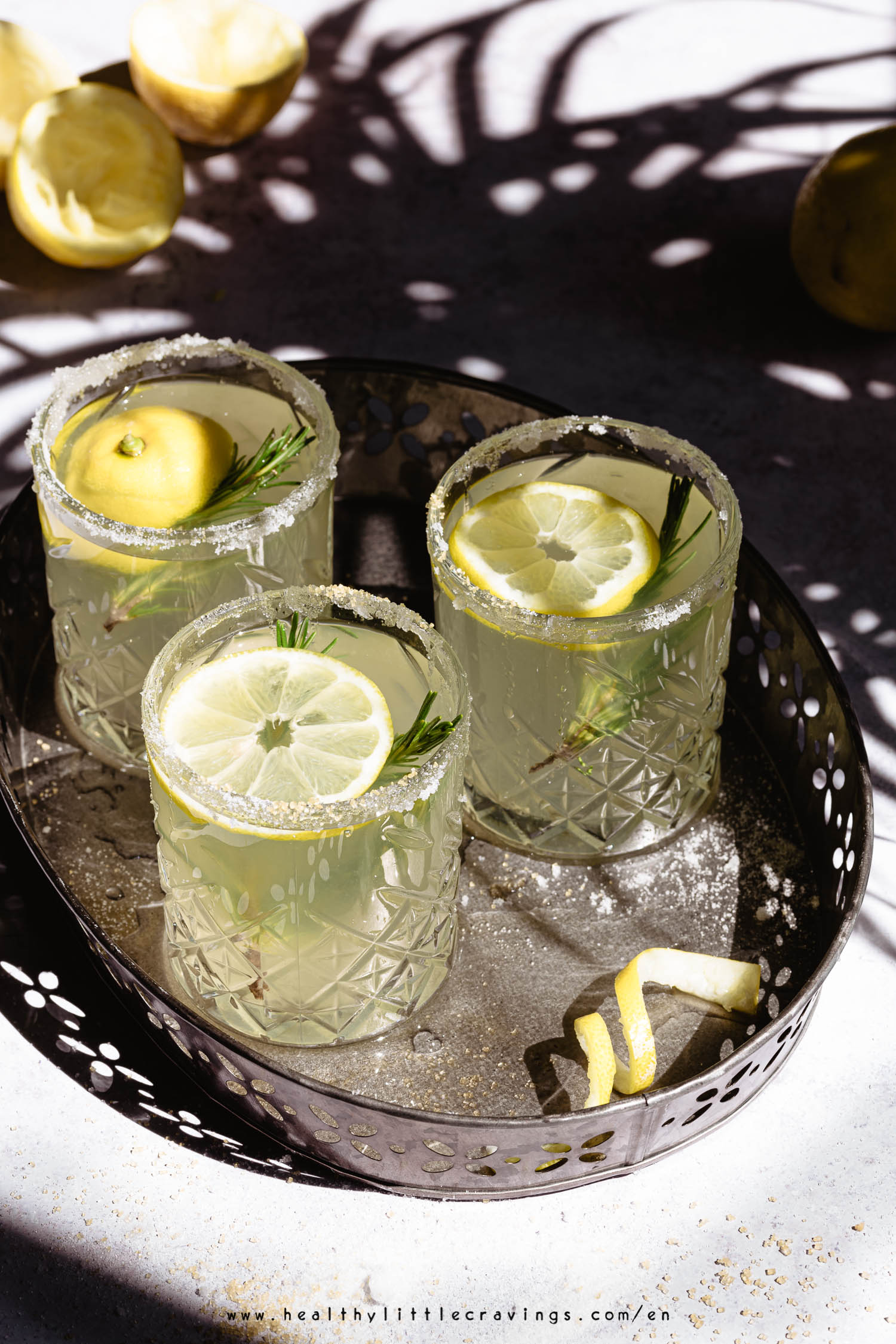 Refreshing rosemary lemonade into 3 glasses