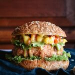 Closeup of grilled salmon burger with mustard and honey
