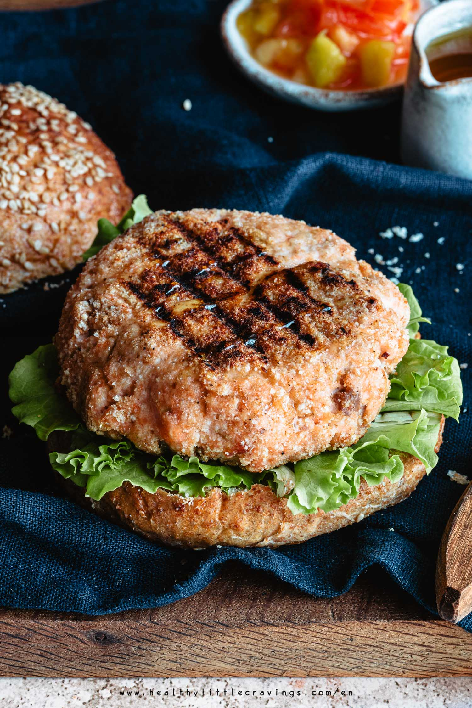 Grilled salmon burgers on a whole bun