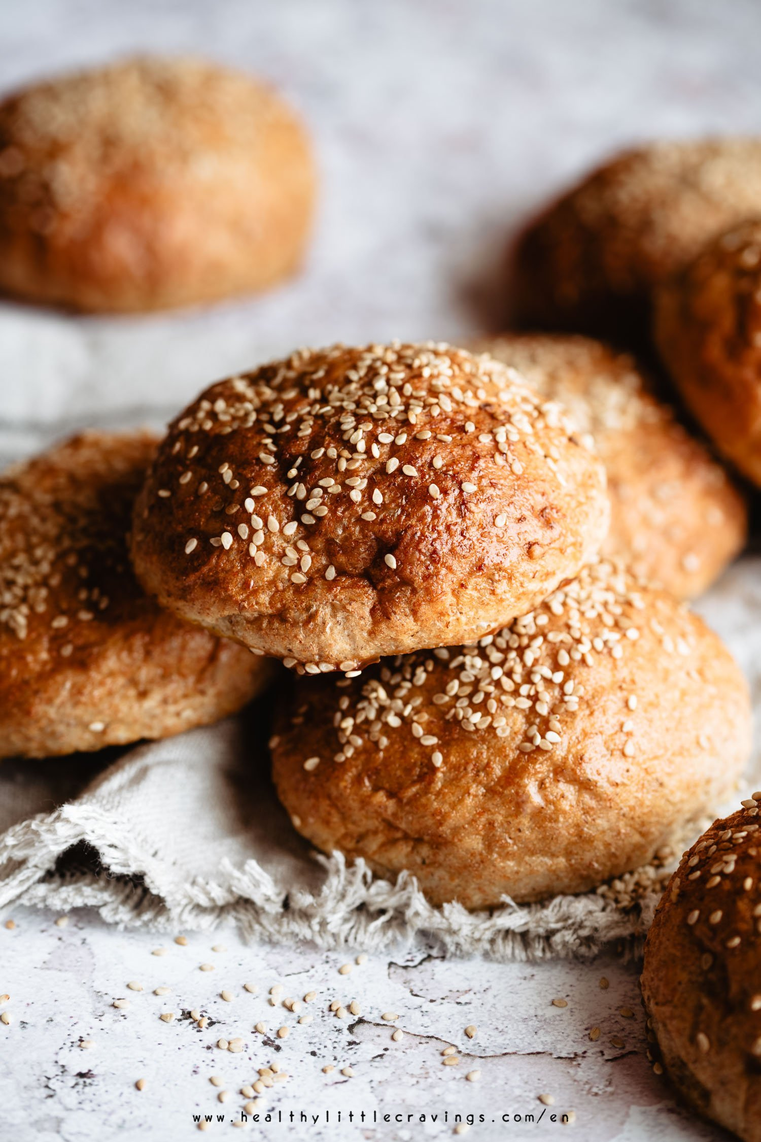 Whole wheat hamburger buns easy recipe using Tangzhong method. Buns with sesame seeds on top