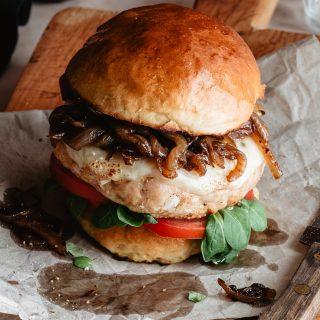 Grilled turkey burgers on a cutting board
