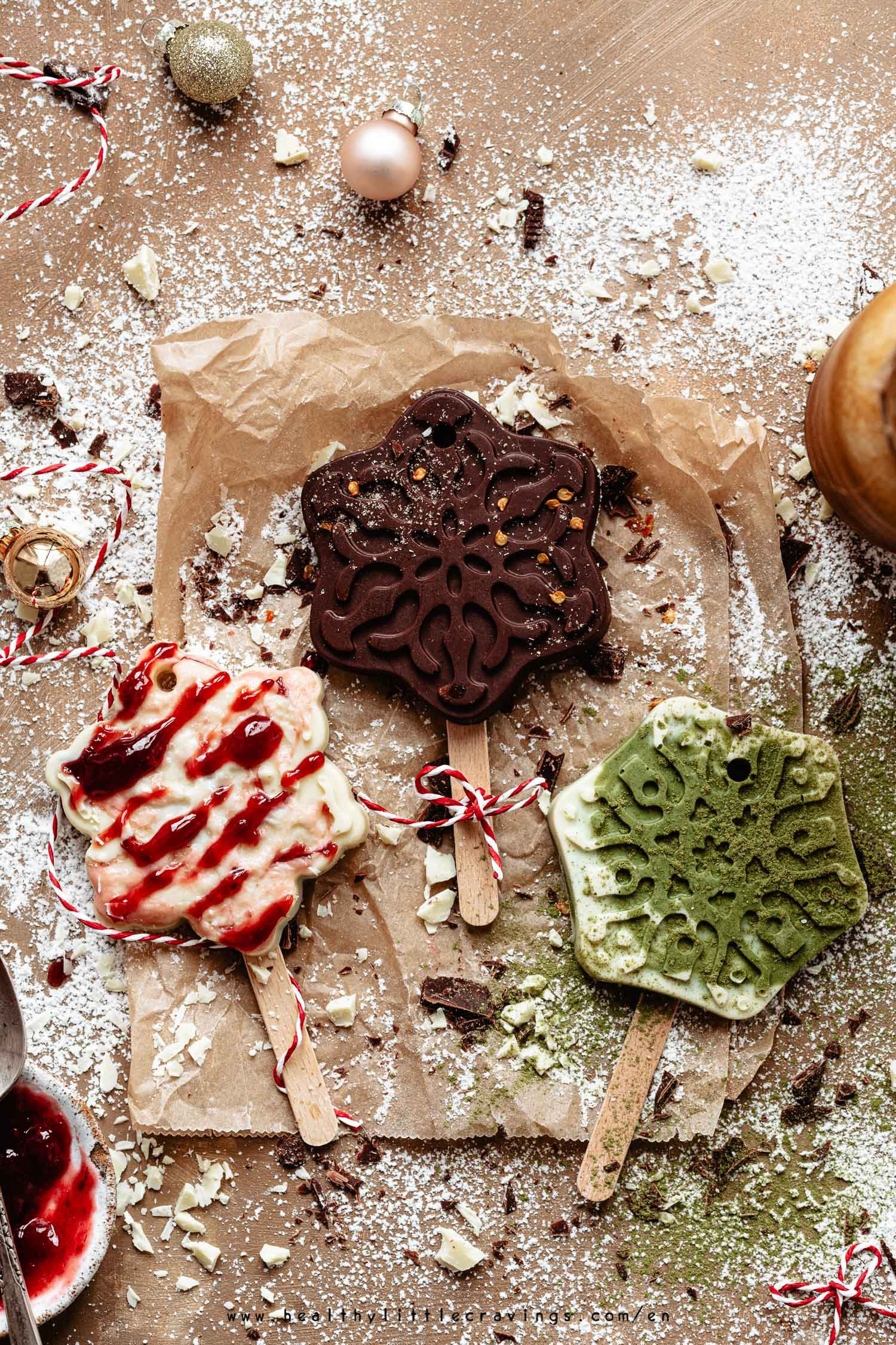Three hot chocolate on stick on parchment paper flat-lay
