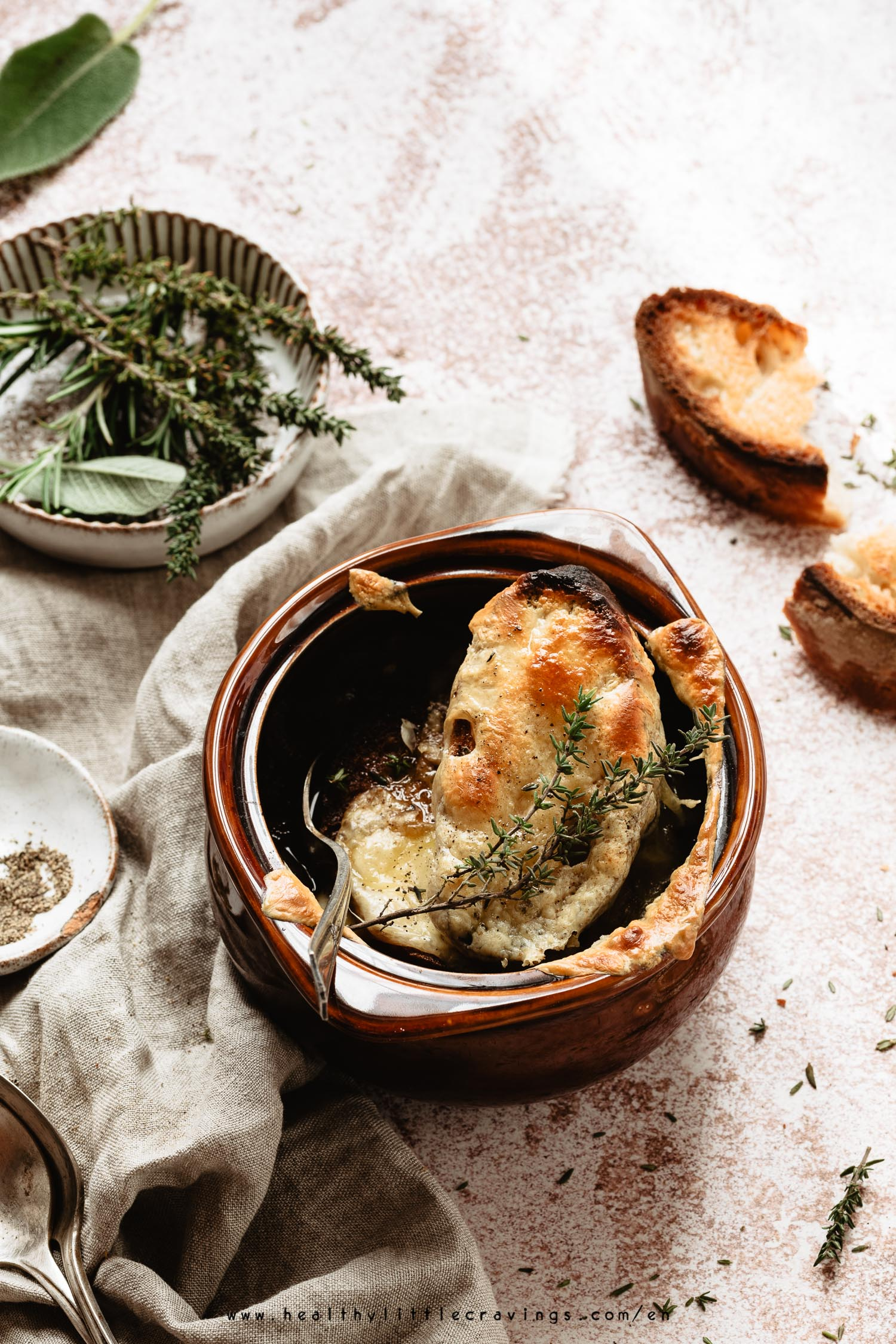 A delicious vegetarian french onion soup into a cocotte
