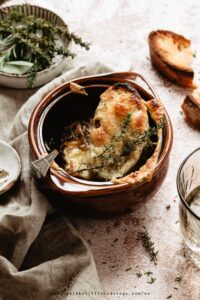 Easy vegetarian french onion soup served with baguette