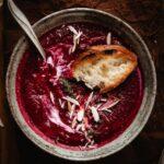 Baguette on a beet soup into a bowl