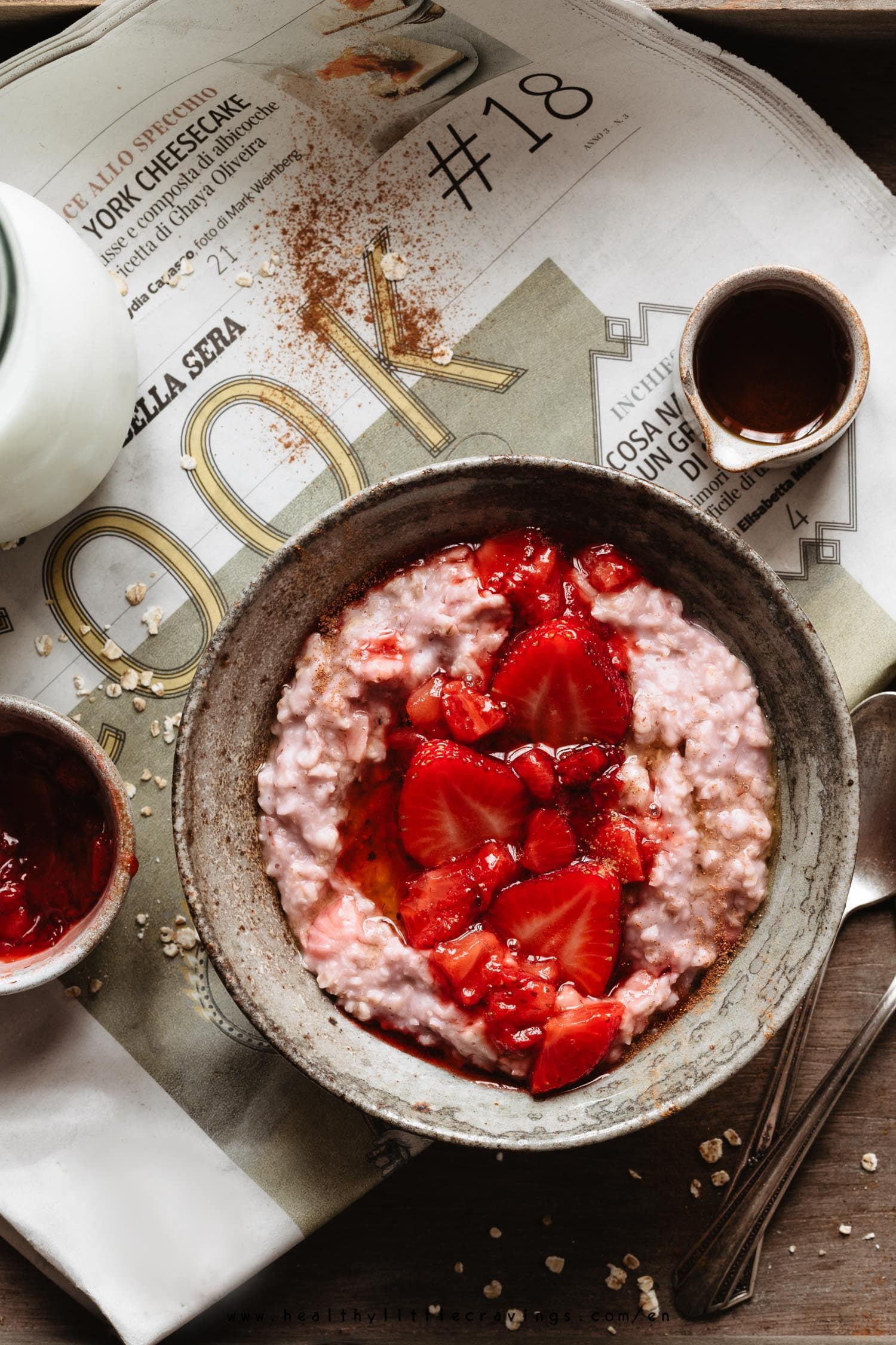 Strawberry oatmeal with maple syrup and a sprinkle of cinnamon into a bowl